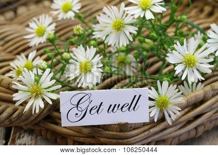 Get well card with chamomile flowers on wicker tray