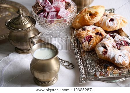 Antique tea-set with Turkish delight and baking on table close-up