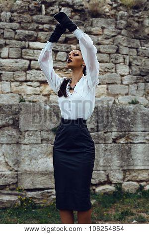 Elegant Brunette Wears White Shirt, Leather Skirt And Gloves