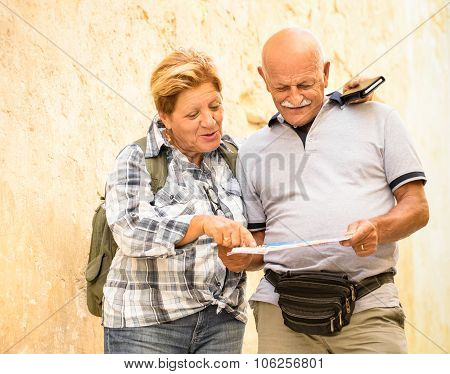 Active Senior Couple Exploring Old Town Of La Valletta With Travel Map - Concept Of Youthful Elderly