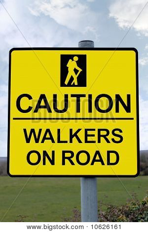 Caution Walkers On Road Sign With Clipping Path