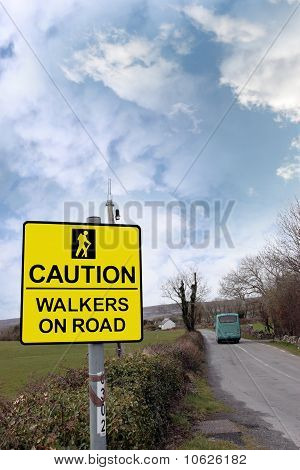 Caution Walkers On Road Sign