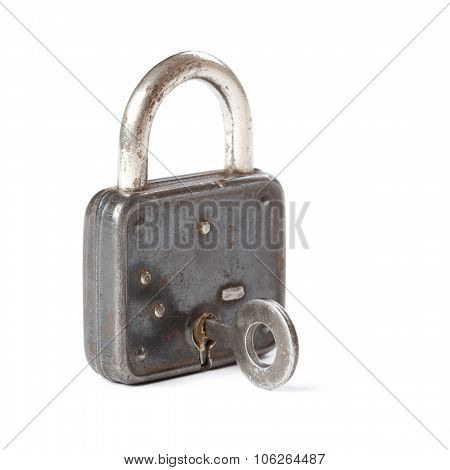 Closeup photography vintage padlock and key on white