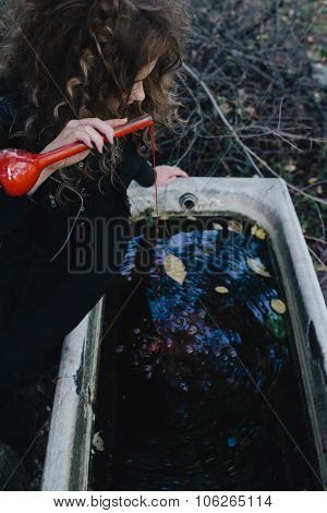 Vintage witch with elixir in hand