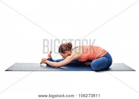 Young beautiful sporty fit woman doing Ashtanga Vinyasa Yoga asana Janu sirsasana A - head-to-knee pose A isolated on white