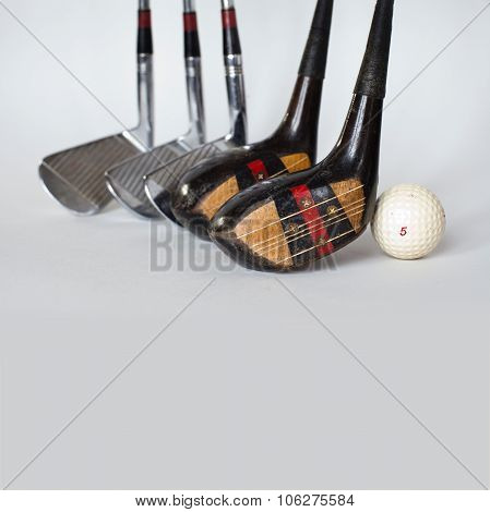 Five vintage, shabby silver, wooden golf clubs