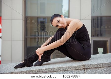 Tender Attractive Ballerina Sitting On The Balusters