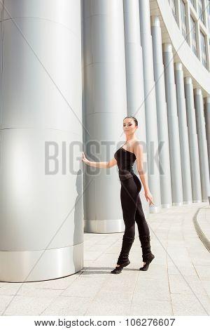 Cute Graceful Ballerina Holding The White Column