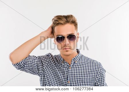 Handsome Man With Glasses Combing His Hair With Fingers