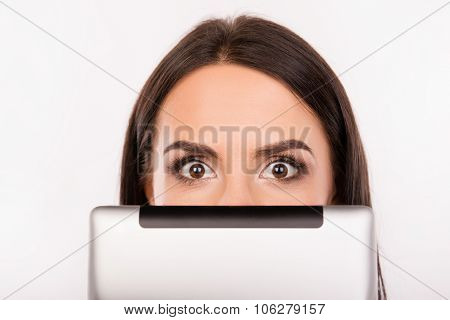 Scared Young Woman Hiding Face Behind The Tablet