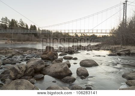 Suspension Bridge Over River