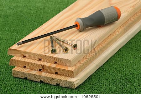 Three boards, screws and screw-driver