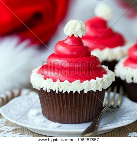 Cupcakes decorated with buttercream santa hats
