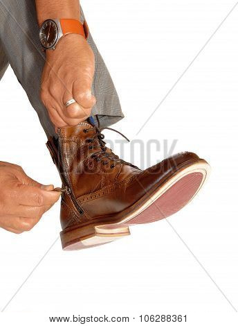 Man Putting On His Shoes.