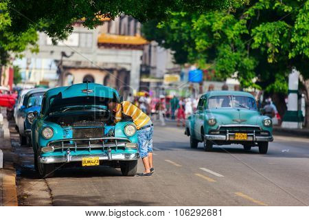 HAVANA, CUBA - JULY 17, 2013: Old retro Chevrolet cars on the street of Old Havana, Havana, Cuba. This is the most common mode of transportation for locals and tourists and are used a