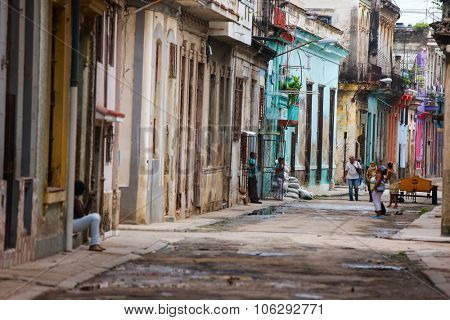 HAVANA, CUBA - JULY 17, 2013: Authentic view of a street of Old Havana with old buildings and people.