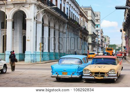 HAVANA, CUBA - JULY 16, 2013: Old vintage Chevrolet cars on the street of Old Havana, Havana, Cuba. This is the most common mode of transportation for locals and tourists and are used as taxis.