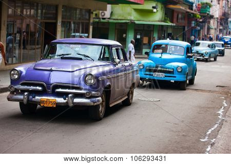 HAVANA, CUBA - JULY 17, 2013: Old vintage Chevrolet cars are on the street of Old Havana, Havana, Cuba. This is the most common mode of transportation for locals and tourists and are used as taxis.