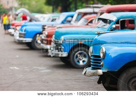 HAVANA, CUBA - JULY 17, 2013: Old vintage Chevrolet cars on the street of Old Havana, Havana, Cuba. This is the most common mode of transportation for locals and tourists and are used as taxis.