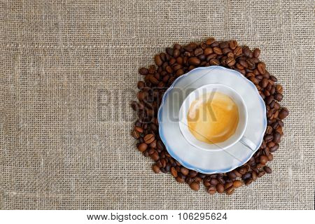 Cup Of Espresso In Stack Of Coffee Bean