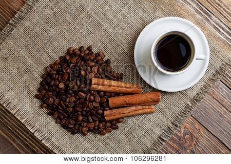 Cup Of Coffee, Coffee Beans And Cinnamon.