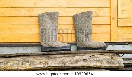 Felt Boots Near Wooden Wall