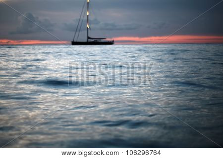 Yacht Floating In The Sea After Sunset