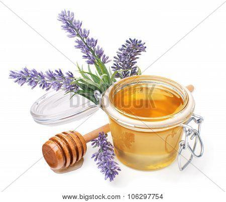 jar of liquid honey with lavender