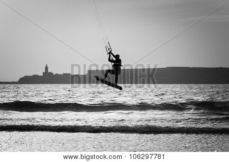 Silhouette Of A Kite Surfer At The Beach