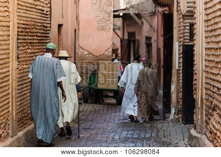 Traditionally Clothed Moroccans Walking In The Medina