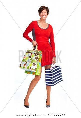 Woman with shopping bags isolated over white background.