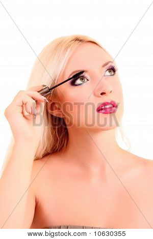 Portrait Of A Young Pretty Blonde  Woman Applying Mascara