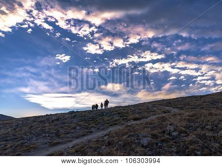 Group of people hiking trail at high altitude