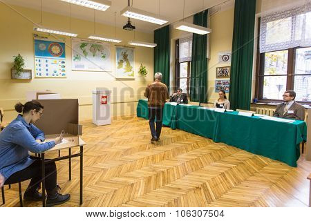 KRAKOW, POLAND - OCTOBER 25, 2015: Unidentified voters at the polling station during polish parliamentary elections to both the Sejm and Senate.