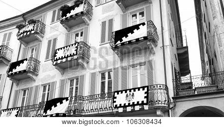 Alba (Cuneo), old decorated palace facade. Black and white photo