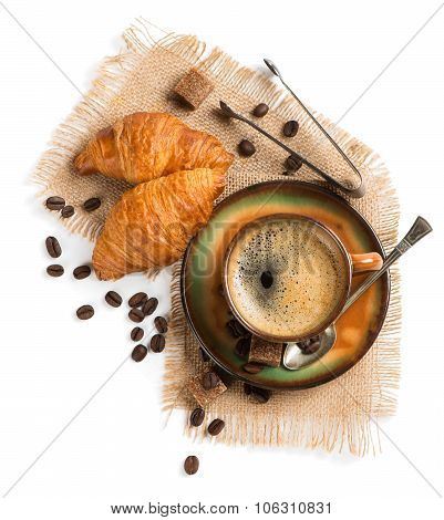 Cup Of Espresso With Croissants Shot From Above