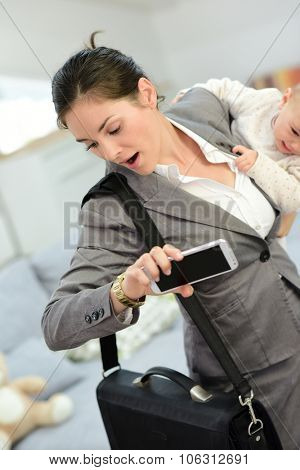Busy businesswoman running late for work in the morning