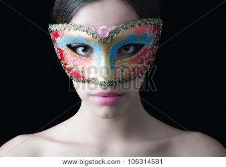 Portrait Of Beautiful Pale Girl With Costume Ball Mask On Her Face