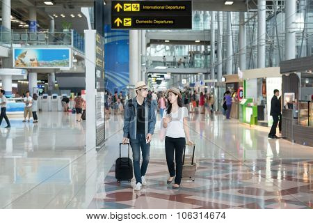 Asian Couple Tourist At The International Airport.