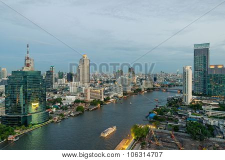 Beautiful Skyline Along Chao Phraya River In Bangkok At Dusk , Thailand