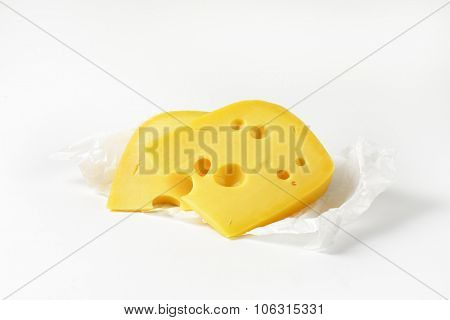 two wedges of fresh cheese on packing paper