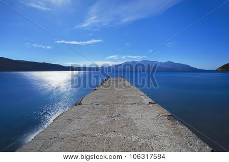 Elba Island Sea, Pier Or Jetty And Capanne Mountain. Tuscany, Italy.