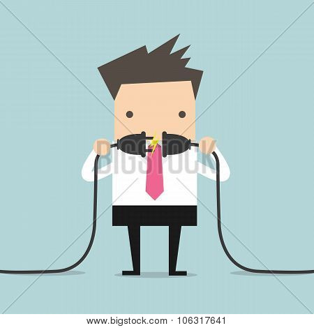 Businessman connecting a power cord