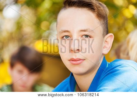 Close-up of boy sitting near yellow tent