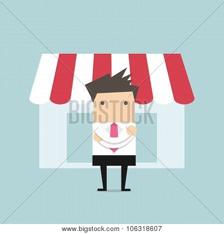 Businessman standing in front of the shop