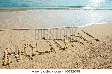Holiday - it is written on sand before a wave