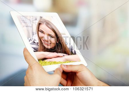 Man having videochat with attractive young woman