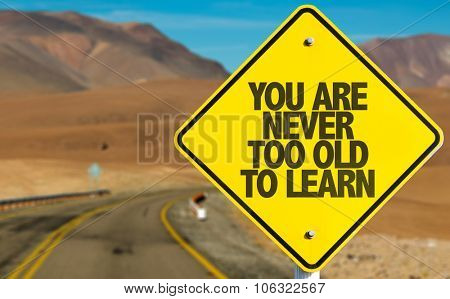 You Are Never Too Old to Learn sign on desert road