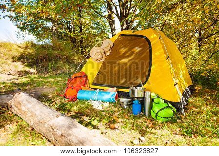 Beautiful campsite with tent, backpacks, day time