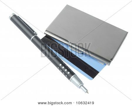 business card holder and pen over white